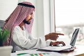 Arabic Businessman Working With Laptop Computer.creative Arab Business People Planning At Modern Wor poster
