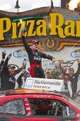 NEWTON, IA - MAY 20, 2012:  Ricky Stenhouse, Jr. (6) holds off the rest of the field to win the Pion