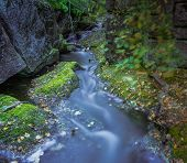A Beautiful Little Stream And Waterfall In The Woods Around The Norwegian City Of Lier, Scandinavia poster