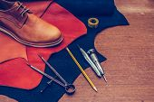 Brown Shoes And Leather Shoemaking Tools And Set Of Leather Craft Tools poster