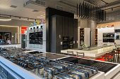 Many gas stoves selling in appliance retail store showroom, ovens and other home appliance at backgr poster