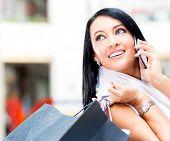 Beautiful shopping woman talking on the phone
