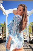 Young woman enjoying the summer at beach bar in Greece