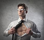 Young businessman showing his chest full of bullet holes