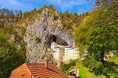 Landscape View Of Ancient Castle In The Cave. Predjama Castle (slovene. Predjamski Grad). It Is A Re poster