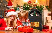 Joy And Happiness. Family Having Fun At Home Christmas Tree. Mom And Kid Play Together Christmas Eve poster