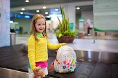 Kids Travel And Fly. Child At Airplane In Airport poster