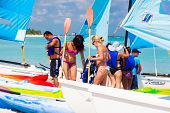 VARADERO,CUBA-MAY 27:Tourists getting ready to go sailing May 27,2012 in Varadero.With over a million visitors per year,Varadero is the main destination for the growing cuban tourism industry