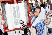 JERUSALEM, ISRAEL - APRIL 26: Jewish reading pray from Torah, ancient scrolls at the western wall on