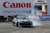 KUALA LUMPUR - MAY 20: Japan's Daito Saito in a Lexus SC430 brake drifts his car leaving a trail of