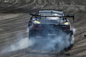 KUALA LUMPUR - MAY 19: Japan's drift champion Daigo Saito in a Lexus SC430 throw gravel and smoke du