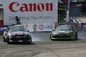 KUALA LUMPUR - MAY 20: Tengku Djan (right) chases Ser Ming Hui (left) at the Formula Drift 2012 Asia