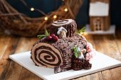 Yule Log Roll Cake For Christmas Decorated With Chocolate Ganache poster