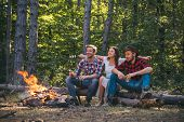 Young Couples Having Picnic In Woods. Romantic Picnic Forest. Young People Having A Camping. Spring  poster