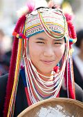 CHIANG MAI, THAILAND - FEBRUARY 4: Traditionally dressed Lisu hill tribe woman in procession on Chiang Mai 36th Flower Festival on February 4, 2012 in Chiang Mai, Thailand
