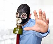 businessman with gas mask in office