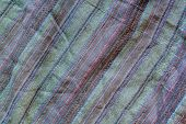 The Texture Of The Fabric With Multi-colored Stripes On The Diagonal. A Lot Of Stitches On The Fabri poster