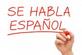 pic of grammar  - Hand writing Se Habla Espanol with red marker on transparent wipe board - JPG