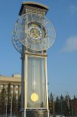 Transparent clock with a pendulum in a central square in Krasnoyarsk