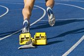 stock photo of sprinters  - Sprinter track and field is starting from starting block - JPG