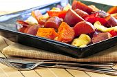 picture of root vegetables  - Vegetarian dish of roasted yams with cheese and peppers - JPG
