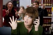 stock photo of unawares  - Annoying woman in a cafe on her cell phone gets the finger - JPG