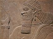stock photo of babylonia  - Ancient Assyrian wall carving of a man showing his head and hand