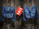 Jeans sale inscription on clothesline