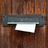 picture of postbox  - Letter box with envelope on wooden door - JPG