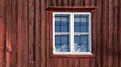 Texture Of A Window On The Old Red Wooden Wall. Traditional Scandinavian House