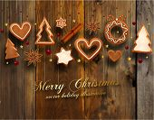 Hanging Gingerbread Christmas Cookies for Xmas Decoration. Wood Texture Background. Vector.
