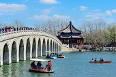 BEIJING, CHINA - APR 5: Summer Palace with bridge over lake on April 5, 2013 in Beijing, China. It w