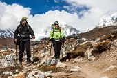Couple Walking And Hiking In Himalaya Mountains