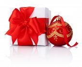 White Gift Box Tied With Red Ribbon And Decorations Christmas Ball Isolated On White Background