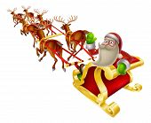 stock photo of sleigh ride  - Cartoon Santa in his Christmas sleigh waving back at the viewer - JPG