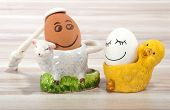 Smiling Egg And Lamb And Chicken Eggcup  On A Wooden Background