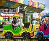 Little Girl In Amusement Park