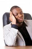 Male businessman sitting, bored, sleeping.  Isolated on white.