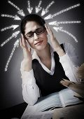Woman student having a headache and stress.