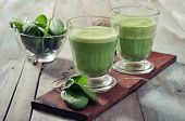 stock photo of celery  - Apple and spinach smoothie in glass on a wooden background - JPG
