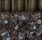 stock photo of bartering  - Underground economy and black market business concept as a forest of trees as a hidden root system under the ground as gears and cog wheels connected together in a secret financial industry network - JPG