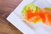 Red caviar and smoked salmon sandwich