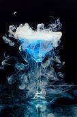 stock photo of vapor  - blue cocktail with splash and ice vapor - JPG