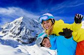 Ski, young couple has fun in mountains