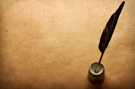 picture of inkwells  - quill pen and inkwell on vintage paper background  - JPG