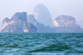 Foggy limestone cliff  tropical sea landscape in Phang nga bay, Thailand