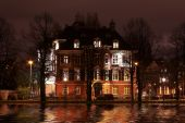 Late medieval house by night along a canal in Amsterdam the Netherlands poster