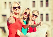 holidays and tourism concept - beautiful blonde women with tourist map showing thumbs up in the city