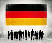 German flag and a group of business people.