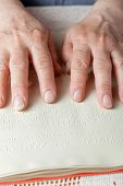 foto of braille  - Blind old woman reading text in braille language - JPG